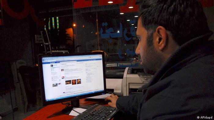 A Syrian man connects on his Facebook account at an internet cafe (AP Photo/Muzaffar Salman)