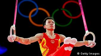 LONDON, ENGLAND - JULY 30: Weiyang Gao of China competes on the rings in the Artistic Gymnastics Men's Team final on Day 3 of the London 2012 Olympic Games at North Greenwich Arena on July 30, 2012 in London, England. (Photo by Ronald Martinez/Getty Images)