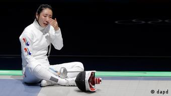 South Korea's Shin A-lam reacts after a women's individual epee fencing semifinals match against Germany's Britta Heidemann at the 2012 Summer Olympics, Monday, July 30, 2012, in London. (AP Photo/Dmitry Lovetsky)
