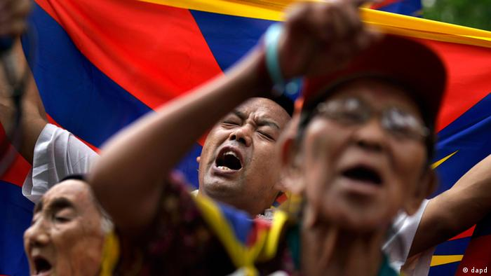 Tibetan exiles shout slogans during a protest against the Chinese government in Delhi, India, Friday, July 13, 2012. (AP Photo/Saurabh Das)