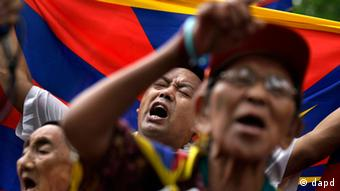 Tibetan exiles shout slogans during a protest against the Chinese government in Delhi, India, Friday, July 13, 2012.