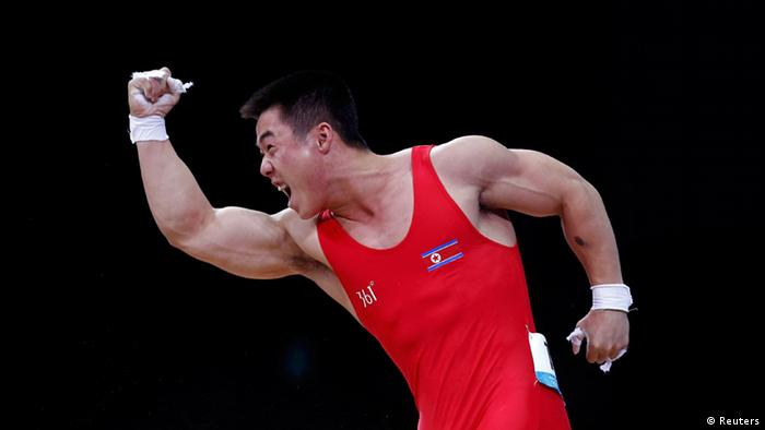 Kim Un Gak celebrates after tying an Olympic record during the men's 62-kilogram weightlifting competition at the London Olympics.