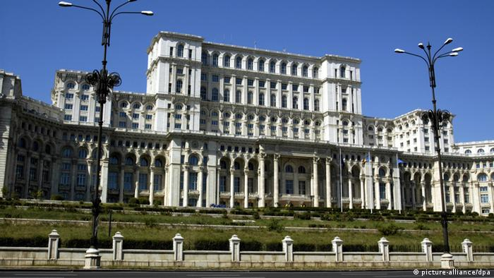 A large white classic European building with a blue-sky background