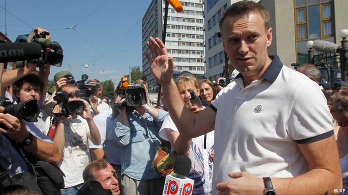 Russian protest leader Alexei Navalny speaks to the media after leaving a headquarter of the Russian Investigation committee in Moscow, Russia, Tuesday, July 31, 2012.