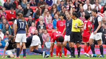 Referee Jenny Palmqvist sends off North Korea's Choe Mi-gyong for a second yellow card offence during their women's football first round Group G match against the U.S. at Old Trafford in Manchester during the London 2012 Olympic Games July 31, 2012.