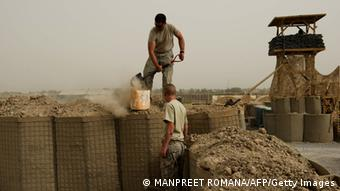 US soldiers of Bravo Troop of 1st Squadron, 71st Cavalry fill a HESCO barrier as they build a watch tower at a forward operating base in Dand district of Kandahar Province in Afghanistan