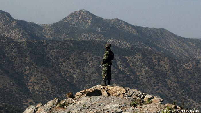 A Pakistan army soldier stands alert, as he monitors the Afghan-Pakistan border at Kundigar post, some 80 kilmeters, 50 miles southwest of Miran Shah, capital of Pakistani tribal belt of North Waziristan, along the Afghanistan border, Sept. 15, 2005. (AP Photo/Anjum Naveed)