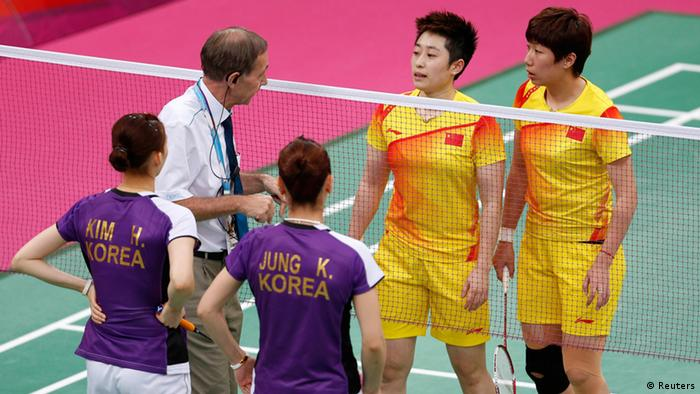 An official (2nd L) speaks to players from China and South Korea during their women's doubles group play stage Group A badminton match during the London 2012 Olympic Games at the Wembley Arena in this July 31, 2012 file photo. Top badminton officials met at Wembley Arena on August 1, 2012 to decide the fate of four women's doubles pairs charged with misconduct for attempting to lose their Olympic matches to secure a more favourable draw. From left: South Korea's Kim Ha-na, Jung Kyung-eun, China's Yu Yang and Wang Xiaoli. REUTERS/Bazuki Muhammad/Files (BRITAIN - Tags: SPORT BADMINTON OLYMPICS)