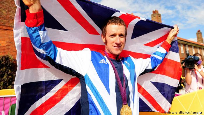 London Olympic Games - Day 5. Great Britain's Bradley Wiggins celebrates winning the Men's Individual Time Trial on day five of the London Olympic Games at Hampton Court Palace, London. Picture date: Wednesday August 1, 2012. See PA story OLYMPICS Cycling Road Women. Photo credit should read: Adam Davy/PA Wire. EDITORIAL USE ONLY URN:14186711