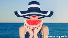 Young stylish lady in a hat at sea with watermelon adult; attractive; background; beach; beautiful; beauty; blue; blur; color; cute; diet; eating; enjoyment; female; food; fresh; fruit; girl; happiness; happy; hat; healthy; juicy; lady; leisure; lifestyle; model; modern; nutrition; outdoors; person; piece; portrait; pretty; red; rest; sea; sensual; sexy; shore; slice; summer; sweet; tasty; travel; tropical; vacation; watermelon; woman; young