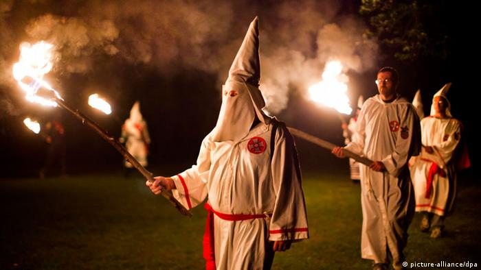 Members of the Ku Klux Klan in Virginia at night, carrying torches