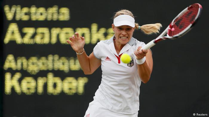Germany's Angelique Kerber returns to Belarus' Victoria Azarenka in their women's singles tennis quarterfinals match at the All England Lawn Tennis Club during the London 2012 Olympic Games August 2, 2012. REUTERS/Stefan Wermuth (BRITAIN - Tags: OLYMPICS SPORT TENNIS)