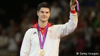 Bronze medalist Dimitrij Ovtcharov of Germany poses on the podium during the medal ceremony during the medal ceremony for the Men's Singles Table Tennis on Day 6 of the London 2012 Olympic Games