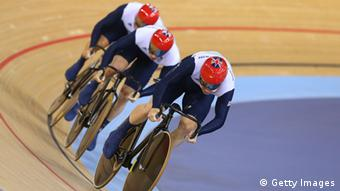Philip Hindes (front), Jason Kenny (center) and Sir Chris Hoy of Great Britain compete in the Men's Team Sprint Track Cycling Final on Day 6 of the London 2012 Olympic Games