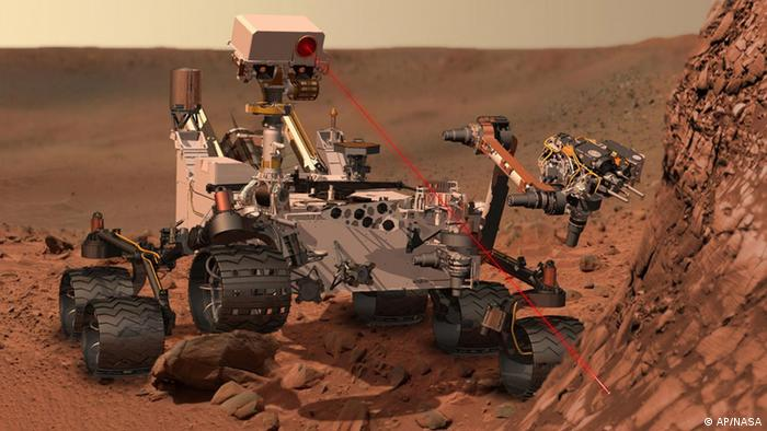 An artist's rendering of the Mars Rover, Curiosity, investigating the red surface of Mars.