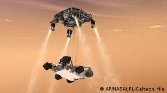 Artist's rendering showing a sky crane lowering the rover onto the surface of Mars.