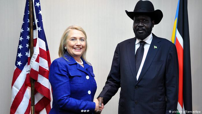 epa03337058 South Sudanese President Salva Kiir (R) greets US Secretary of State Hillary Clinton (L) in Juba, South Sudan, 03 August 2012. Secretary Clinton arrived in Juba early 03 August as part of her African tour, during which she is visiting Uganda, Kenya, South Sudan, Malawi, Nigeria, Benin and South Africa to promote the United States strategy in regards to Sub-Saharan Africa. EPA/PHILIP DHIL