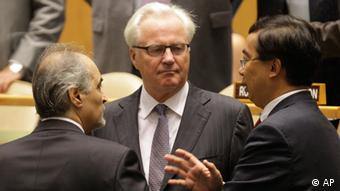 Syria's U.N. Ambassador Bashar Ja'afari, left, speaks to Russia's U.N. Ambassador Vitaly Churkin, center, and China's deputy U.N. Ambassador Wang Min before the United Nations General Assembly passed a draft resolution condemning Syria at the United Nations on Friday, Aug. 3, 2012. (Photo: AP)