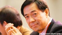 --FILE--Bo Xilai, then Governor of Liaoning province and son of former Chinese Vice Premier Bo Yibo, attends the China Entrepreneur Summit 2003 in Beijing, China, 6 December 2003. Chinas Communist Party has suspended former high-flying politician Bo Xilai from its top ranks and named his wife a suspect in the murder of a British businessman, a dramatic turn in a scandal shaking leadership succession plans. The decision to banish Bo from the Central Committee and its Politburo effectively ends the career of Chinas brashest and most controversial politician, widely seen as pressing for a top post in Chinas next leadership to be settled later this year. The official Xinhua news agency confirmed on Tuesday (10 April 2012) that Bo had been suspended from his party posts, and separately reported that his wife, Gu Kailai, was suspected in the murder of Briton Neil Heywood.
