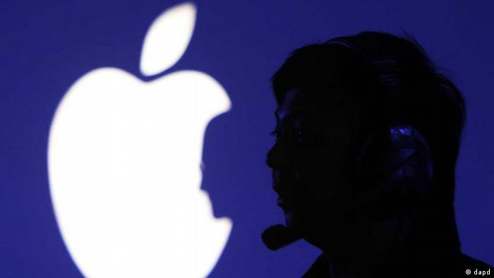 A man is seen by a logo resembling an Apple logo in Manila, Philippines, Friday, Oct. 14, 2011. Apple fans called Friday Steve Jobs Day as a tribute to him. (ddp images/AP Photo/Pat Roque) /eingst. sc