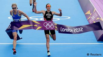 Nicola Spirig (R) of Switzerland wins the women's triathlon final during the London 2012 Olympic Games at Hyde Park August 4, 2012. Lisa Norden (L) of Sweden took the silver and Erin Densham of Australia took the bronze.