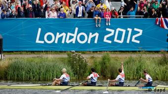 Great Britain's, left to right, Andrew Triggs Hodge, Tom James, Pete Reed and Alex Gregory wave to the grandstand after winning the gold medal for the men's rowing four in Eton Dorney, near Windsor, at the 2012 Summer Olympics, Saturday, Aug. 4, 2012.