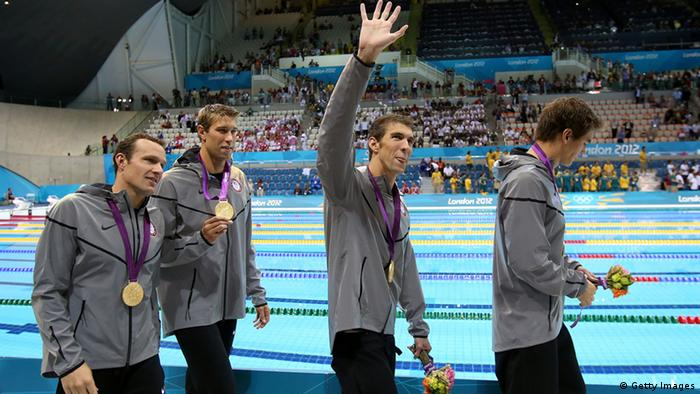 Gold medallists (L-R) Brendan Hansen, Matthew Grevers, Michael Phelps and Nathan Adrian of the United States celebrate following the medal ceremony for the Men's 4x100m Meldey Relay Final on Day 8 of the London 2012 Olympic Games at the Aquatics Centre on August 4, 2012 in London, England.