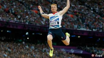 Britain's Greg Rutherford competes in the men's long jump during athletics competition in the Olympic Stadium at the 2012 Summer Olympics, Saturday, Aug. 4, 2012, in London.