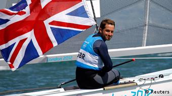 Britain's Ben Ainslie smiles as he crosses the finish line to win the Finn class sailing race at the London 2012 Olympic Games in Weymouth and Portland, southern England, August 5, 2012.