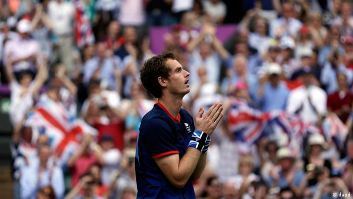 Britain's Andy Murray reacts after defeating Switzerland's Roger Federer to win the men's singles gold medal match at the All England Lawn Tennis Club at Wimbledon, in London, at the 2012 Summer Olympics, Sunday, Aug. 5, 2012.