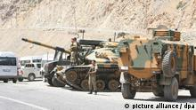 Turkish soldiers and tanks wait in front of Gecimli military base where Kurdish rebels attacked near Hakkari, Turkey 05 August 2012<br /> (c) dpa - Bildfunk+++ epa03342821<br />