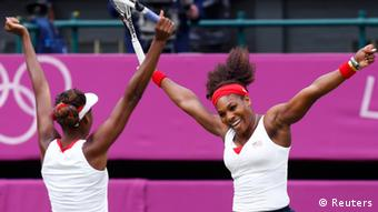 Sisters Serena Williams (R) and Venus Williams of the U.S. celebrate after defeating Czech Republic's Andrea Hlavackova and Lucie Hradecka in the women's doubles tennis gold medal match at the All England Lawn Tennis Club during the London 2012 Olympic Games August 5, 2012. REUTERS/Stefan Wermuth (BRITAIN - Tags: OLYMPICS SPORT TENNIS TPX IMAGES OF THE DAY)