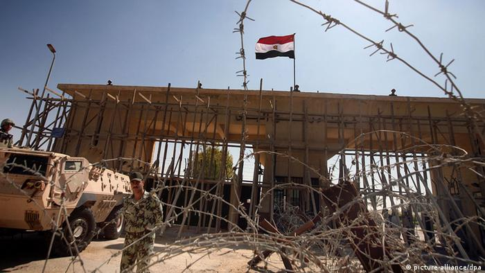 Egyptian border guards watch closed Rafah border crossing with Gaza Strip