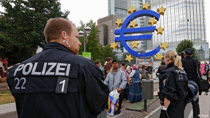 Police in Frankfurt remove protesters from the Occupy Movement.