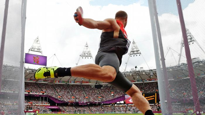 Germany's Robert Harting takes a throw in a men's discus throw qualification round during the athletics in the Olympic Stadium at the 2012 Summer Olympics, London, Monday, Aug. 6, 2012.