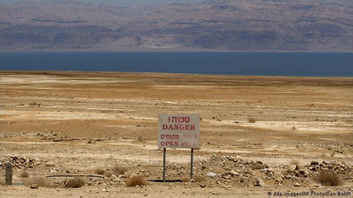 Dead Sea with warning sign