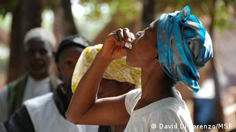 A woman takes the oral vaccine. (photo: David Di Lorenzo/MSF)