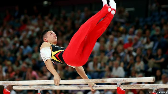 Marcel Nguyen of Germany competes on the parrallel bars during the Artistic Gymnastics Men's Parallel Bars final on Day 11 of the London 2012 Olympic Games at North Greenwich Arena on August 7, 2012 in London, England.