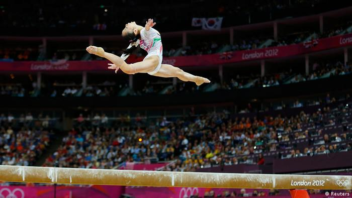 China's Deng Linlin competes in the women's gymnastics balance beam final in the North Greenwich Arena during the London 2012 Olympic Games August 7, 2012. REUTERS/Mike Blake (BRITAIN - Tags: SPORT OLYMPICS SPORT GYMNASTICS)