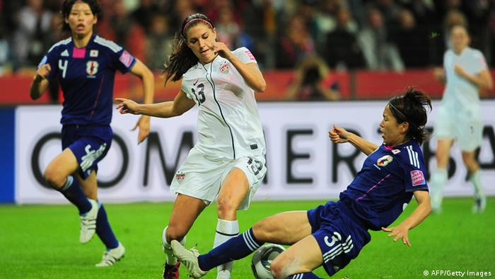 Japan's defender Azusa Iwashimizu (R) and USA's striker Alex Morgan (C) vie for the ball during the FIFA Women's Football World Cup final match of Japan vs USA on July 17, 2011 in Frankfurt/M., western Germany.