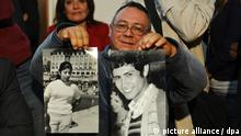 Rigoberto Gaona, uncle of Pablo Javier Gaona Miranda, holds the pictures of Ricardo Gaona Paiva (R) and Maria Rosa Miranda (L), kidnapped during the last dictatorship in Argentina, during a press conference in Buenos Aires, Argentina, August 7, 2012. The human rights group Grandmothers of Plaza de Mayo announced the return of the identity of Pablo Javier Gaona Miranda, grandchild number 106 which retrieves his history after he was illegally seized during the military dictatorship ruled between 1976 and 1983 in Argentina. Photo: Seergio Goya/dpa/aa