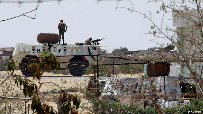 Egyptian soldiers stand guard at a checkpoint in Rafah city on the Egyptian border, August 6, 2012.