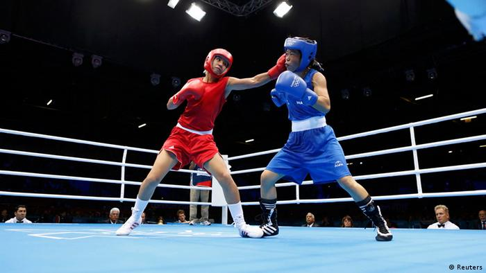 Source News Feed: EMEA Picture Service ,Germany Picture Service Maroua Rahali of Tunisia (L) fights India's Chungneijang Mery Kom Hmangte during their quarterfinal Women's Fly (51kg) boxing match at the London Olympic Games August 6, 2012. REUTERS/Murad Sezer (BRITAIN - Tags: SPORT BOXING OLYMPICS)