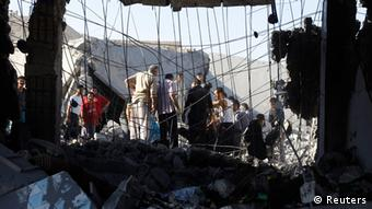 Men search for bodies under rubble of a house, destroyed by a Syrian Air force air strike REUTERS/Goran Tomasevic