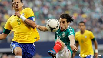 Mexico's Jesus Zaval (back) and Severo Meza (right) vie for the ball with Brazil's Neymar (lrft) during the friendly match June 3, 2012 at Arlington, Texas (United States). Mexico won 2-0.