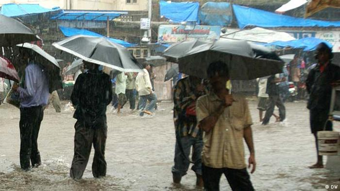 Residents in Delhi braving a downpour