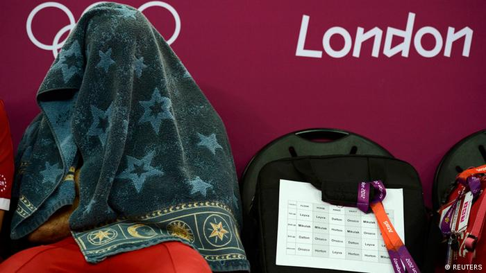 Danell Leyva wears his distinctive blue and gray colored towel prior to competing at the London Olympics.