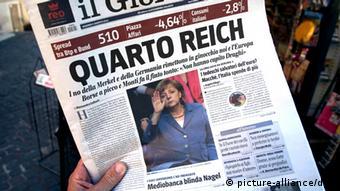Das Titelblatt der italienischen Zeitung «Il Giornale» vom 03.08.2012 aufgenommen in Castel Gandolfo. Das Blatt aus dem Medienimperium von Silvio Berlusconi hat die Äußerungen von EZB-Chef Mario Draghi zur Rettung des Euro kommentiert. «Heil Angela», heißt es auf der Titelseite unter einem Foto, das die Kanzlerin zeigt, wie sie die rechte Hand hebt. Foto: Karl-Josef Hildenbrand dpa/lby +++(c) dpa - Bildfunk+++