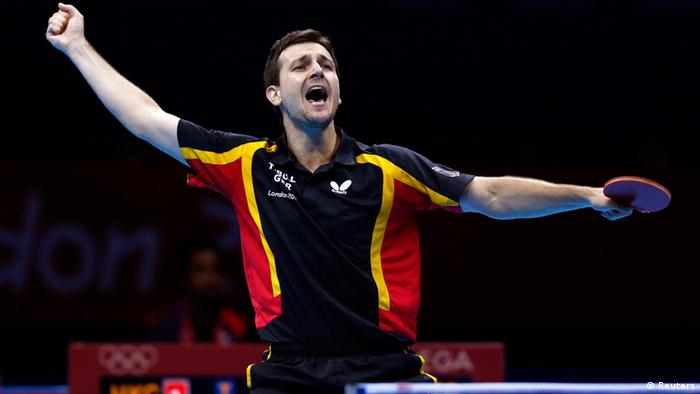 Germany's Timo Boll celebrates winning against HongKong's Jiang Tianyi in their men's team bronze medal table tennis singles match at the ExCel venue during the London 2012 Olympic Games August 8, 2012. Germany took the bronze medal. REUTERS/Grigory Dukor (BRITAIN - Tags: SPORT OLYMPICS SPORT TABLE TENNIS)