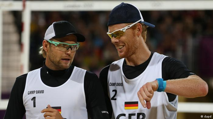 Germany's Jonas Reckermann, right, and Julius Brink, left, react during their quarterfinal men's beach volleyball match against Brazil at the 2012 Summer Olympics